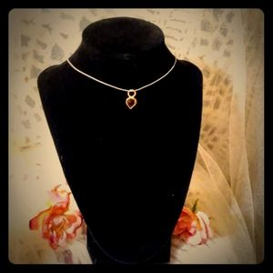 Choker necklace with gold and ruby charm